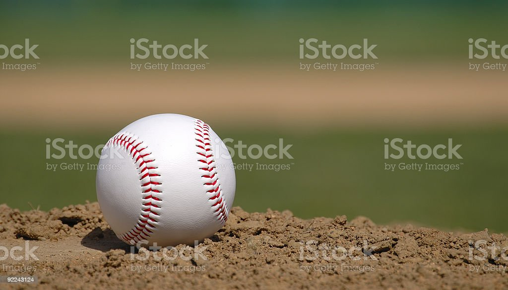 Baseball on pitcher's mound stock photo