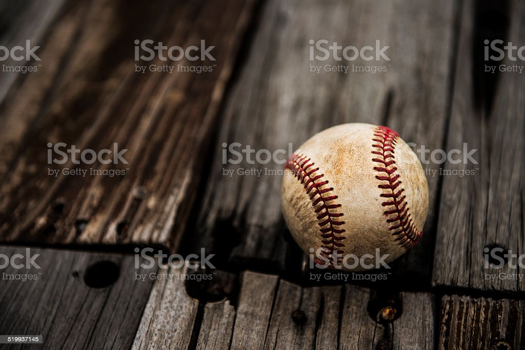 Baseball on rustic wooden background stock photo