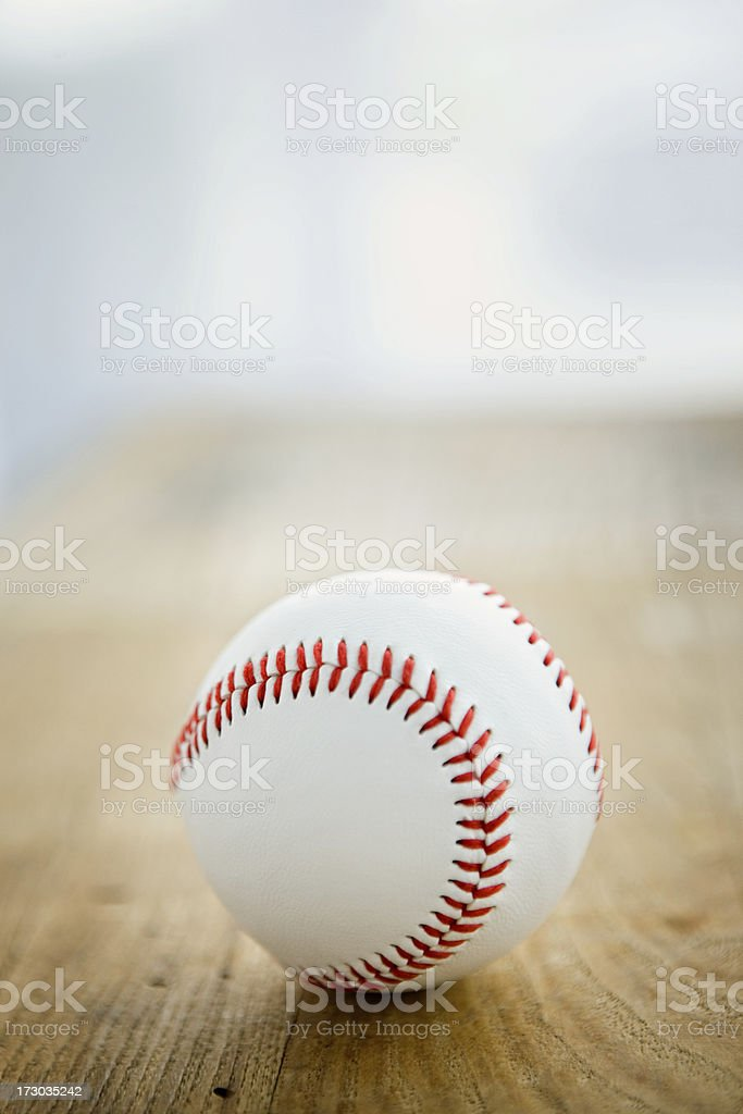 Baseball on wooden bench stock photo