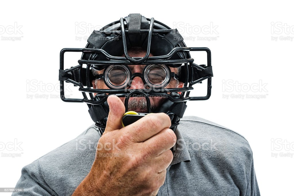 Baseball or Softball Home Plate Umpire checking indiactor stock photo