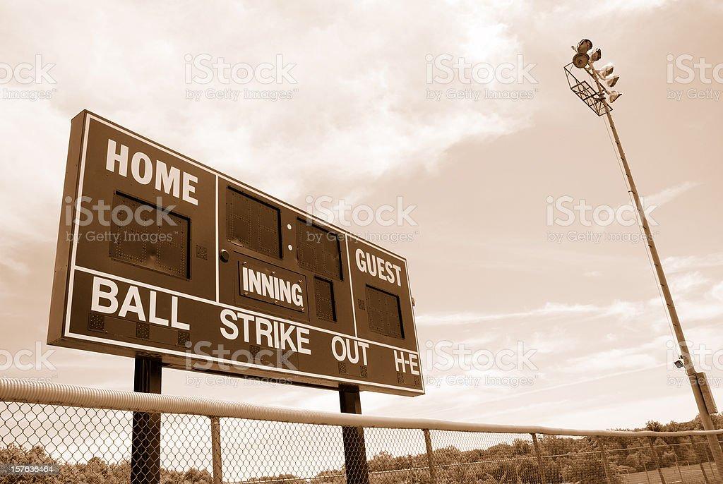 Baseball or softball scoreboard with night lights stock photo