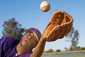 Baseball Outfielder Catching Fly Ball