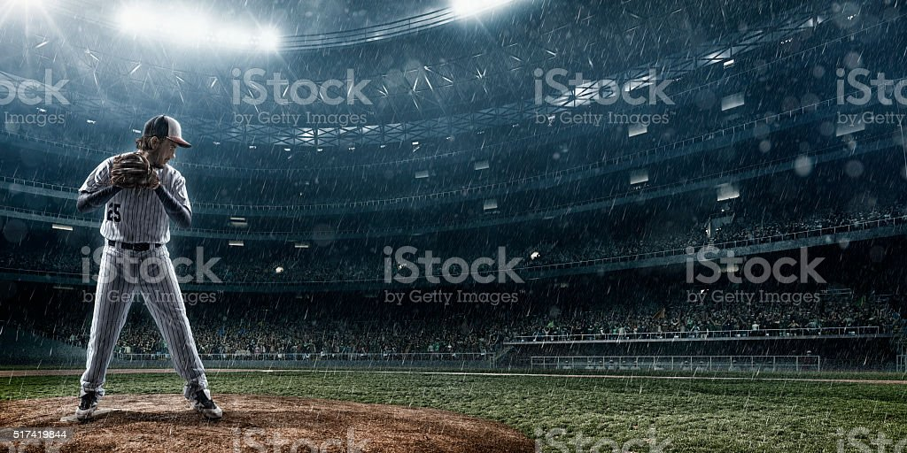 Baseball pitcher in action stock photo