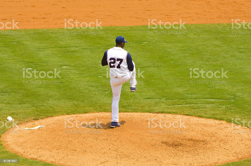 Baseball Pitcher Throwing a Baseball towards Homeplate stock photo