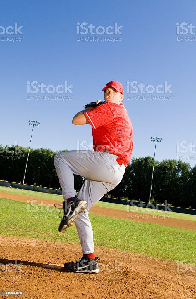 Baseball Pitcher Throwing a Pitch stock photo