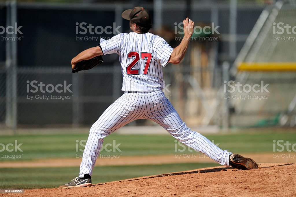 Baseball pitcher throwing the ball stock photo