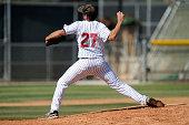 Baseball pitcher throwing the ball