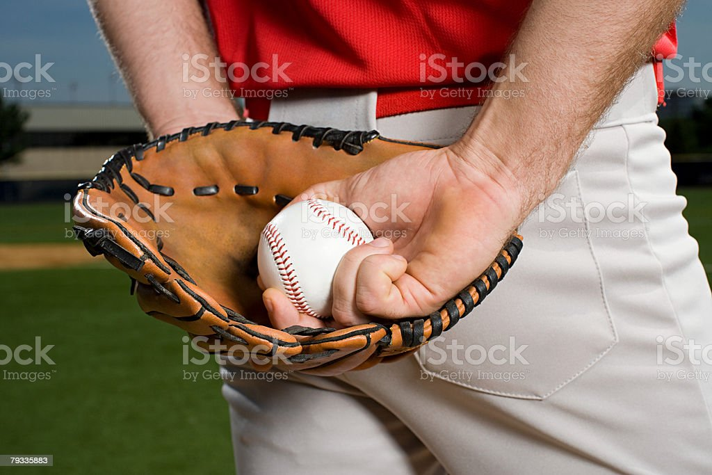 Baseball pitcher with glove and ball stock photo
