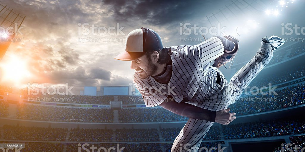 A baseball player after he has just thrown a ball stock photo