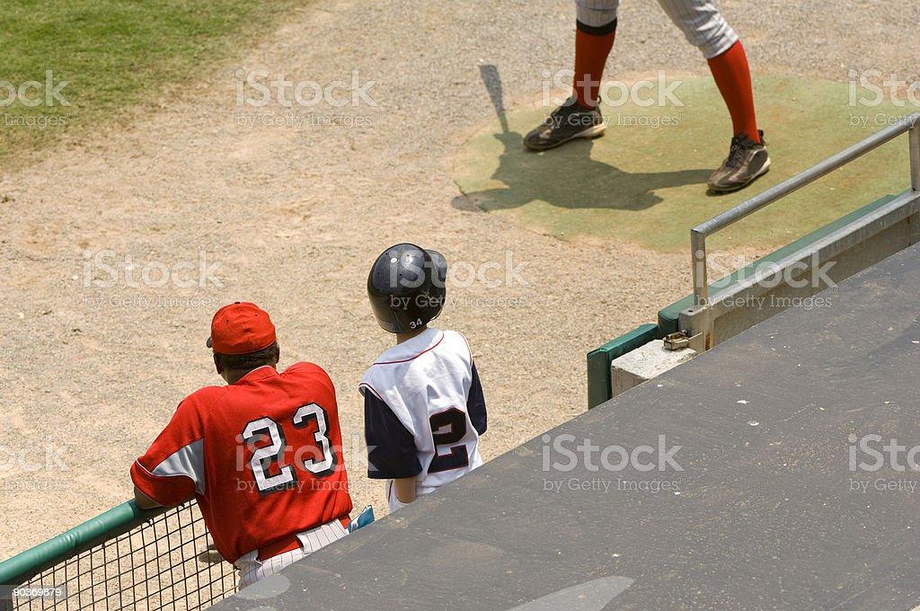 Baseball Player and Baseball Coach standing in dugout at a Baseball Game royalty-free stock photo