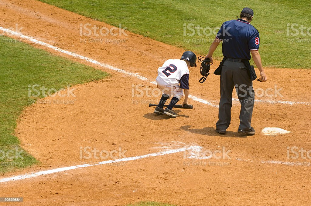Baseball Player at Home Plate of a Baseball Game with Umpire stock photo