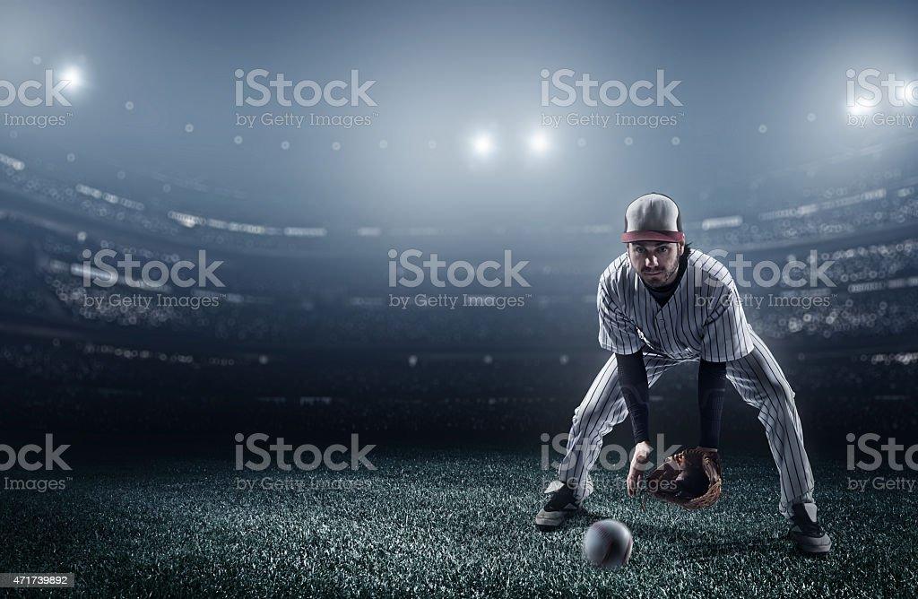 Baseball player catching a ball in stadium stock photo
