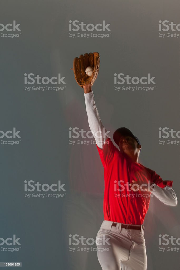 Baseball player catching ball in glove royalty-free stock photo