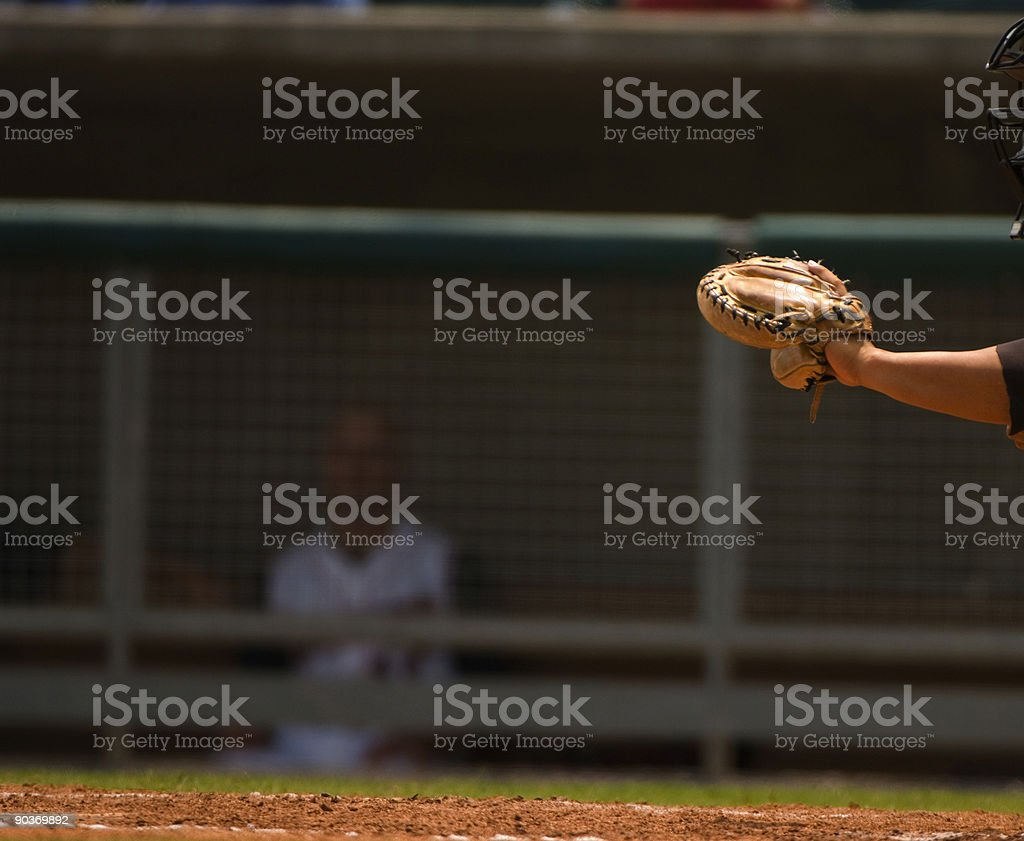 Baseball Player Catching Baseball at Home plate. stock photo