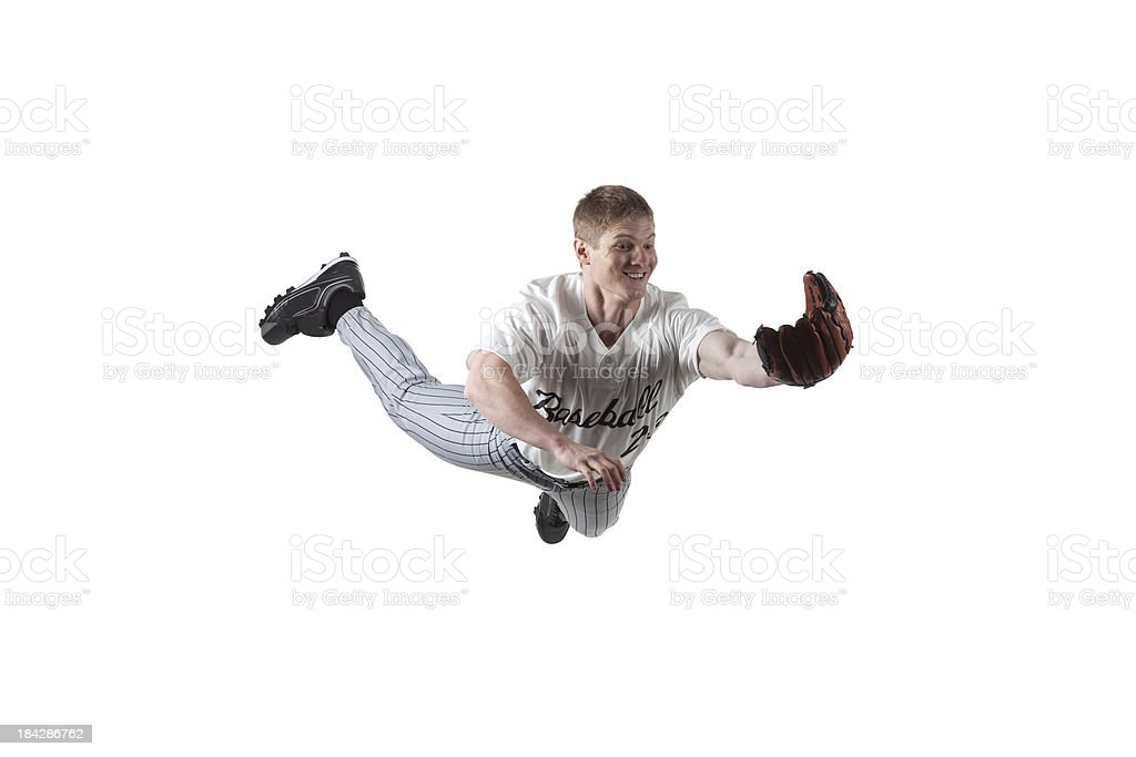Baseball player diving to catch the ball stock photo