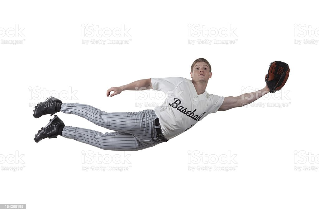 Baseball player diving to catch the ball royalty-free stock photo