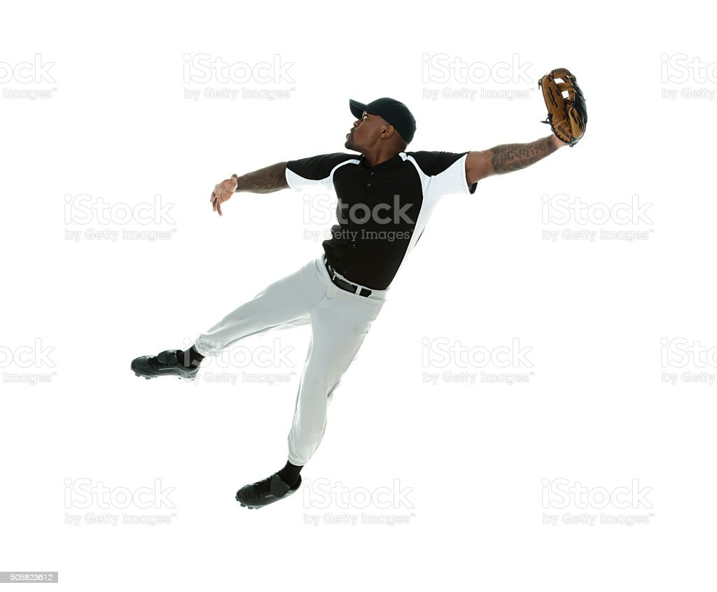 Baseball player fielding stock photo