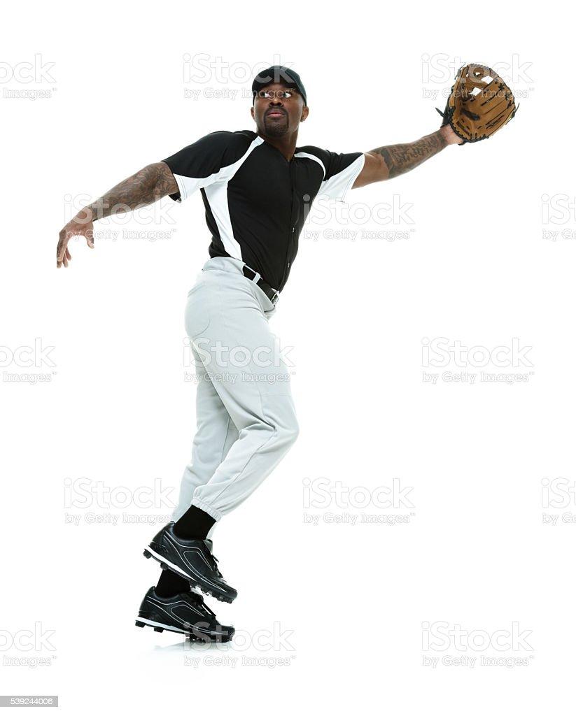 Baseball player fielding stock photo
