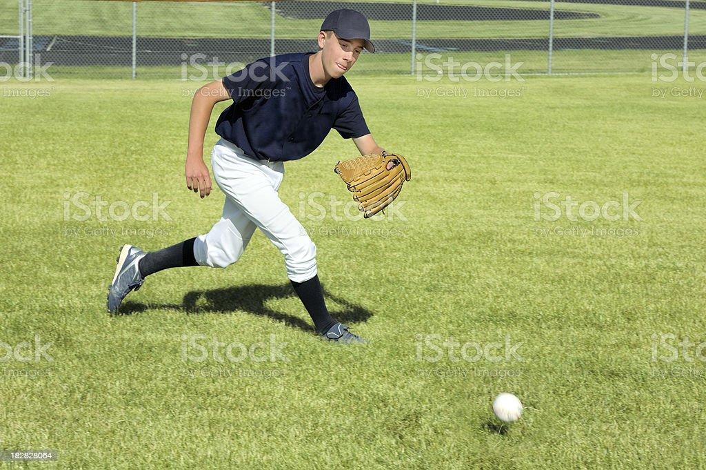 Baseball Player Fields a Ground Ball stock photo