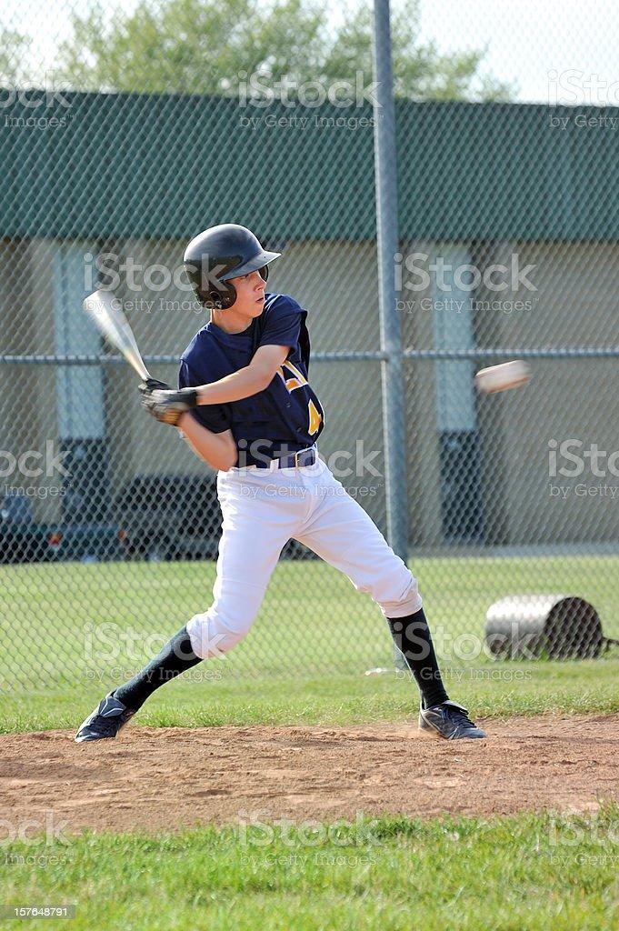 Baseball Player Hitting Ball stock photo