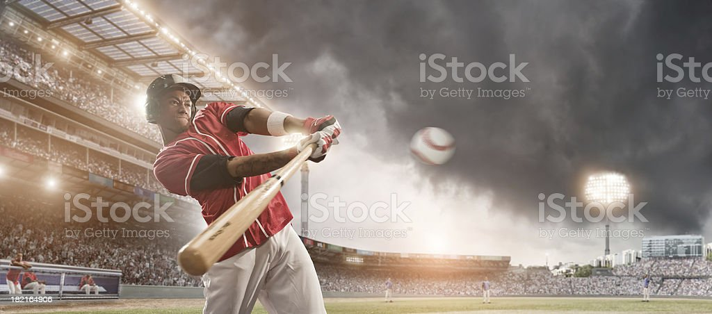 Baseball Player Hitting Ball stock photo