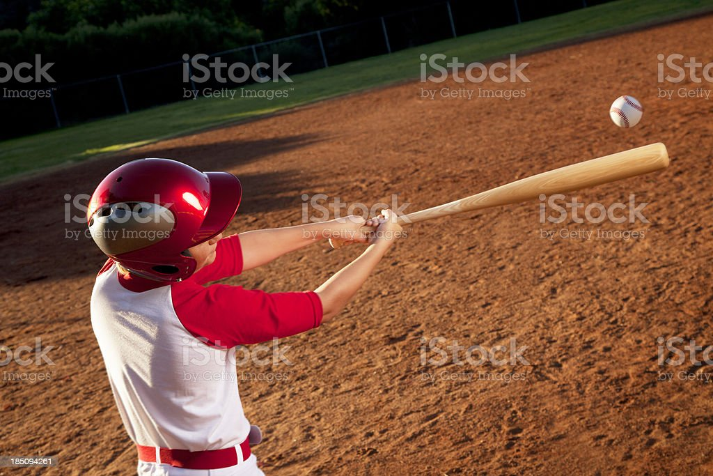 Baseball Player Hitting the Ball royalty-free stock photo