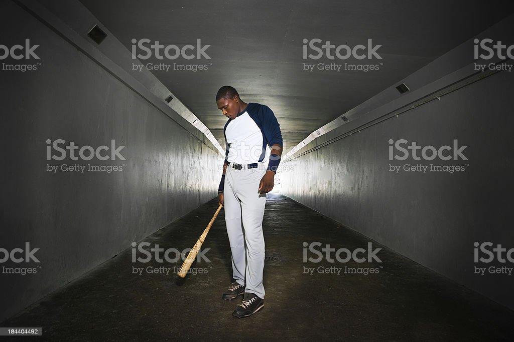 Baseball player holding a bat royalty-free stock photo