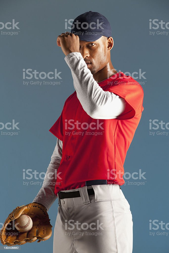 Baseball player holding ball in glove royalty-free stock photo
