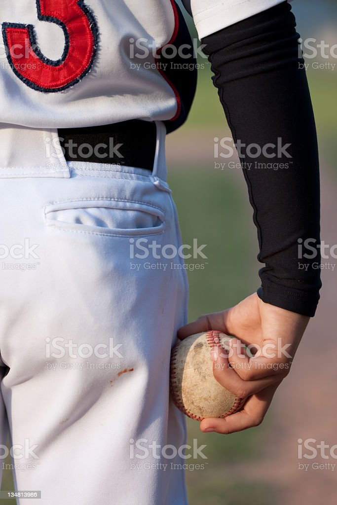 Baseball player holding baseball royalty-free stock photo
