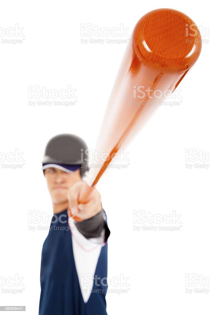Baseball player holding bat over white background royalty-free stock photo