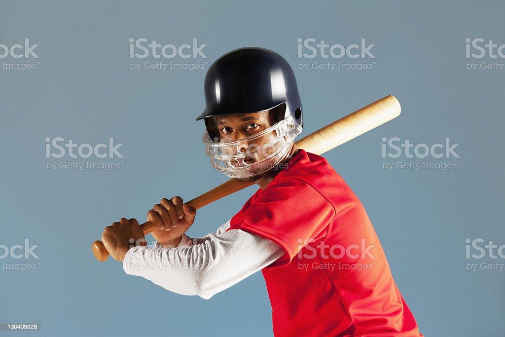 Baseball player holding bat stock photo
