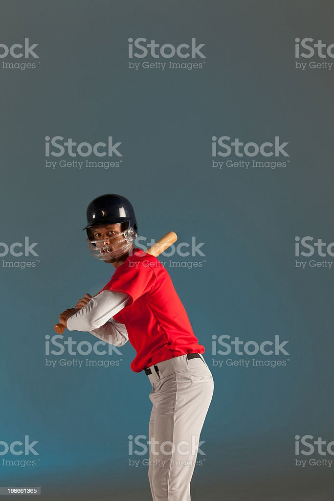 Baseball player holding bat royalty-free stock photo