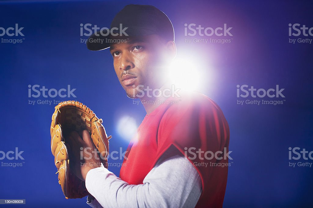 Baseball player holding glove royalty-free stock photo