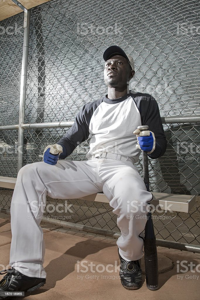 Baseball Player in the Dugout stock photo