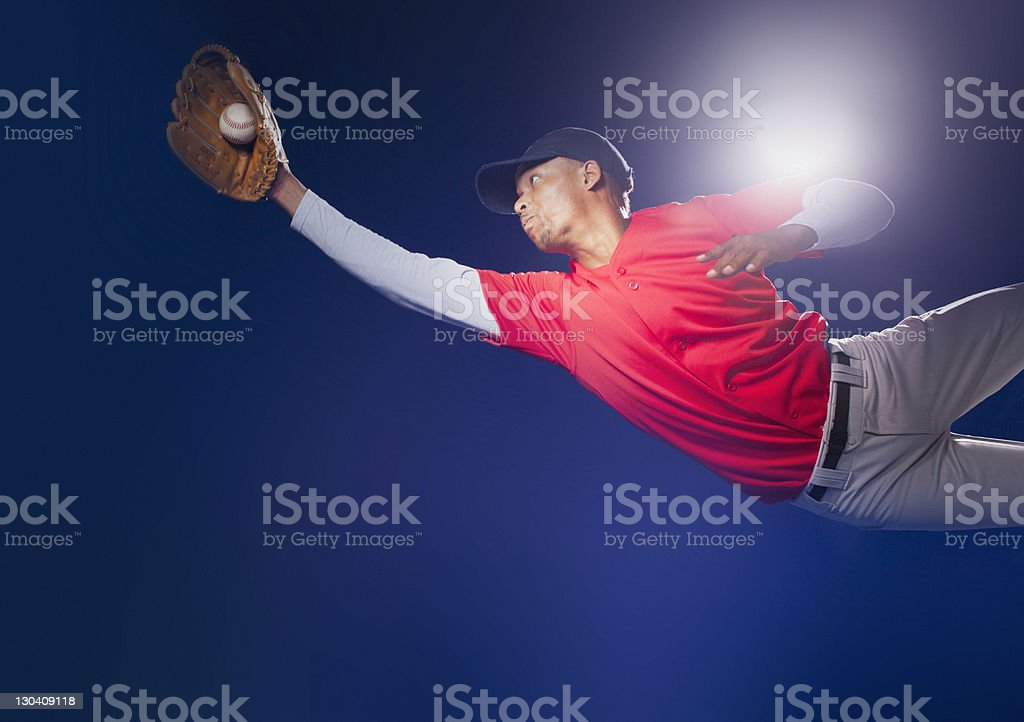 Baseball player lunging for ball royalty-free stock photo