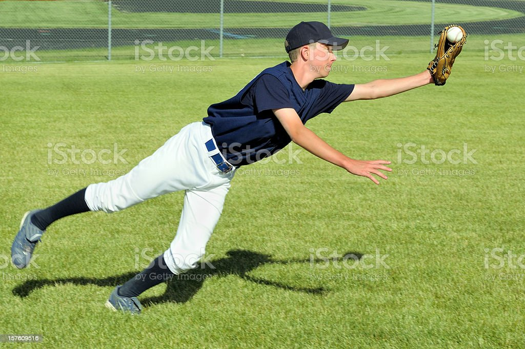 Baseball Player Makes a Diving Catch stock photo