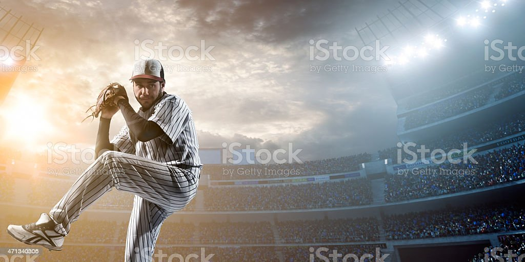 Baseball player pitching a ball in a stadium stock photo