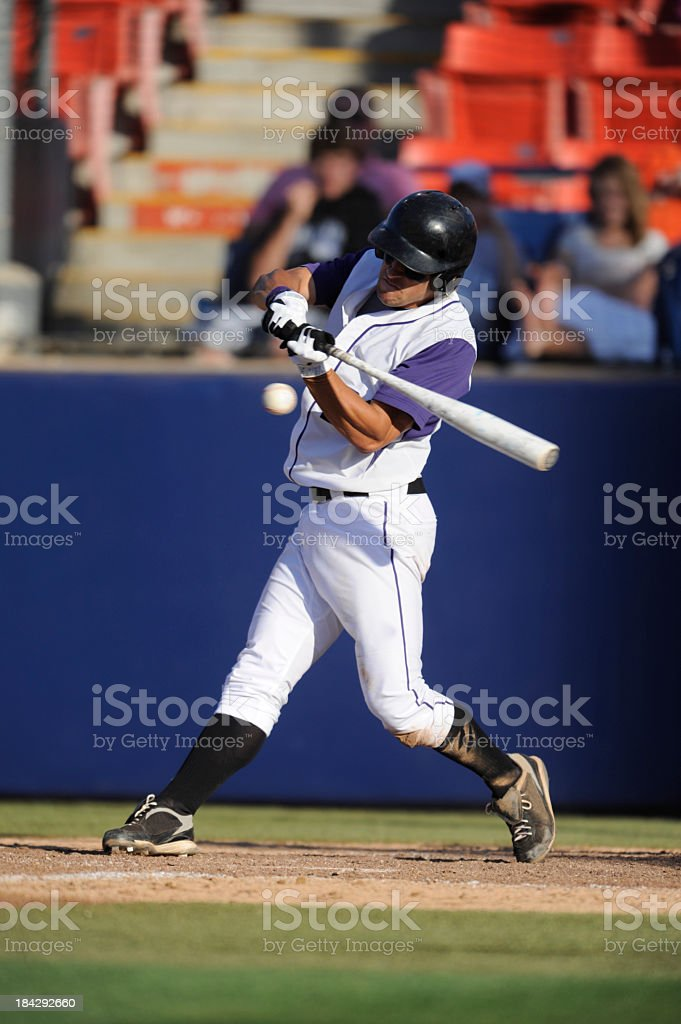 Baseball player playing a game, in which he is the hitter stock photo