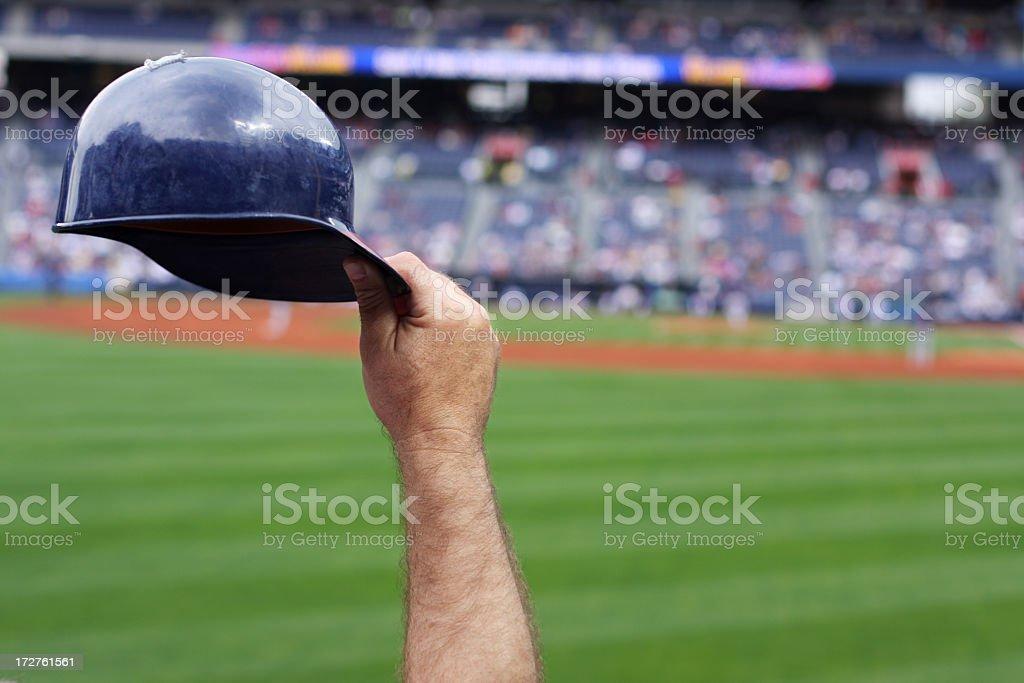 Baseball player raising his hard hat stock photo