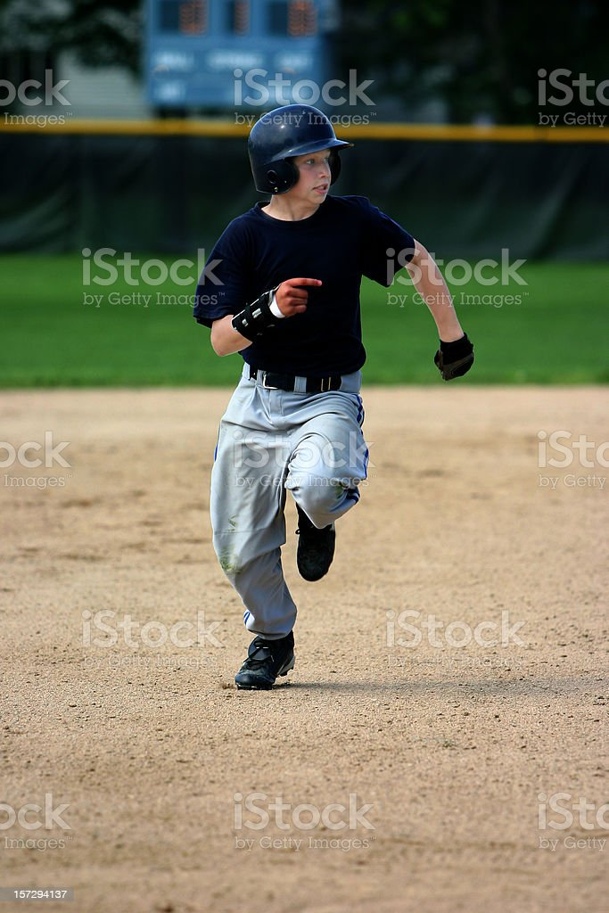 baseball player running the bases royalty-free stock photo