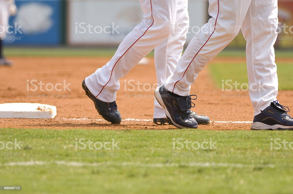Baseball Player Running to First Baseball during Baseball Game stock photo