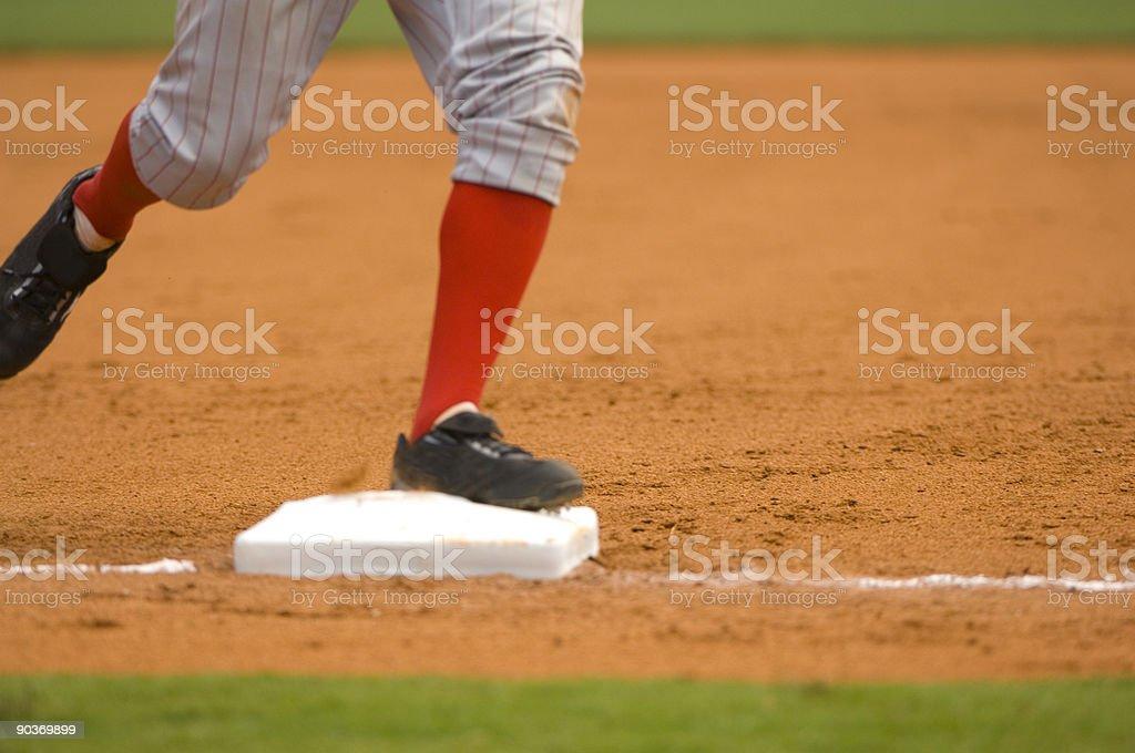 Baseball Player Running to First Baseball during Baseball Game stock photo