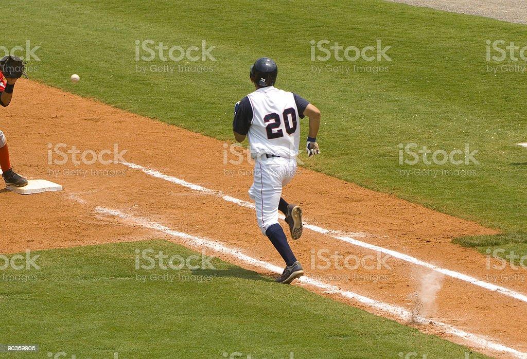 Baseball Player Running to First Baseball during Baseball Game royalty-free stock photo