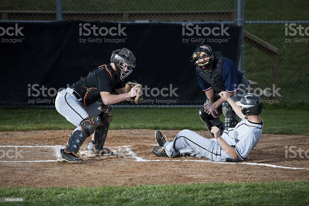 Baseball Player Slides Into Home Plate royalty-free stock photo