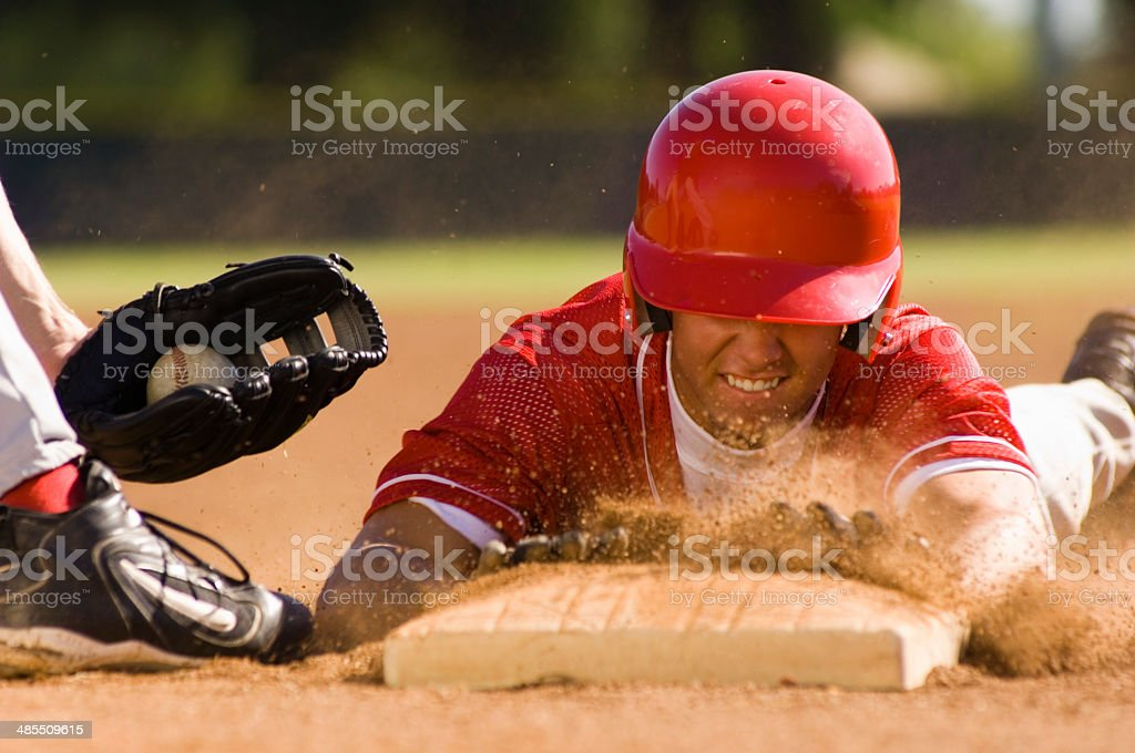 Baseball Player Sliding Into Base stock photo
