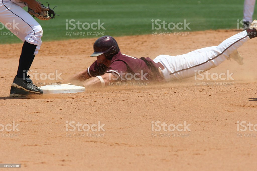 A baseball player sliding to the plate stock photo