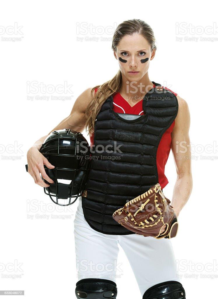 Baseball player standing and looking at camera stock photo