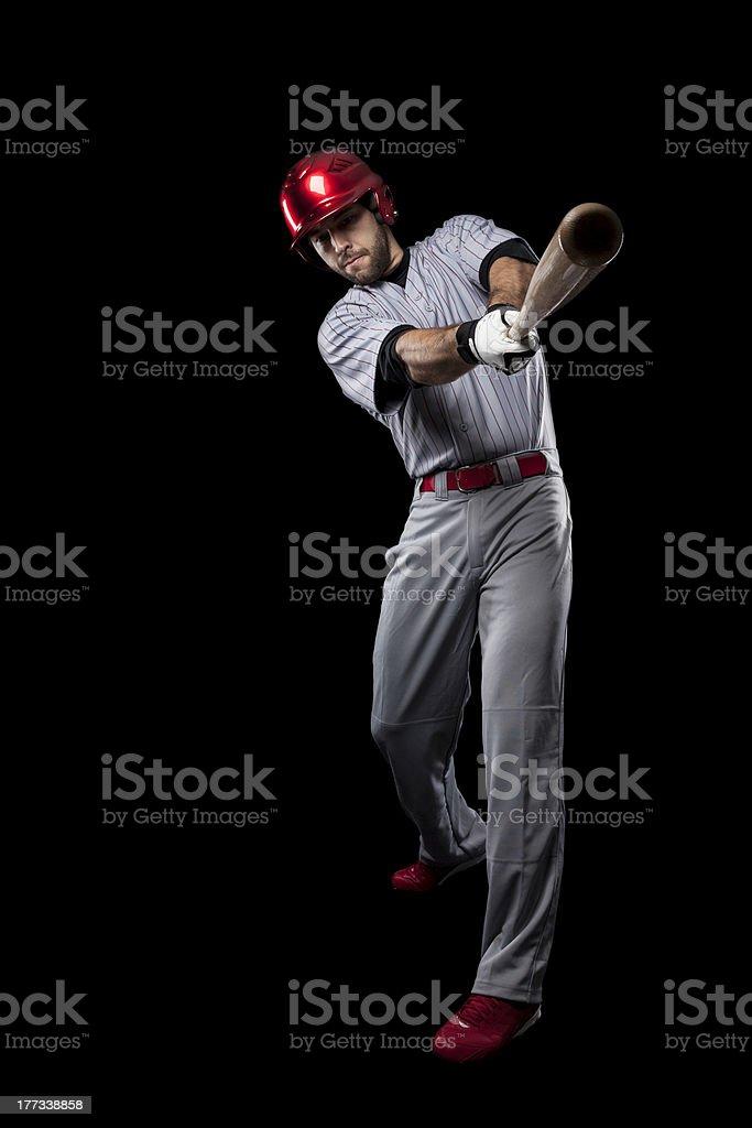 Baseball player swinging a bat at the camera stock photo