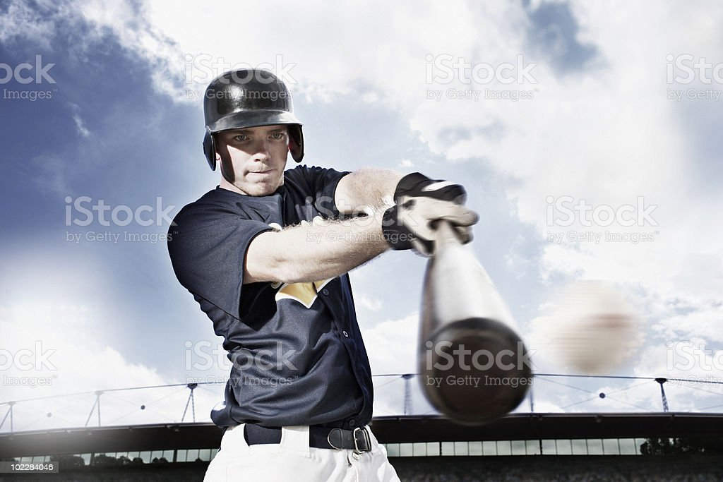 Baseball player swinging baseball bat royalty-free stock photo
