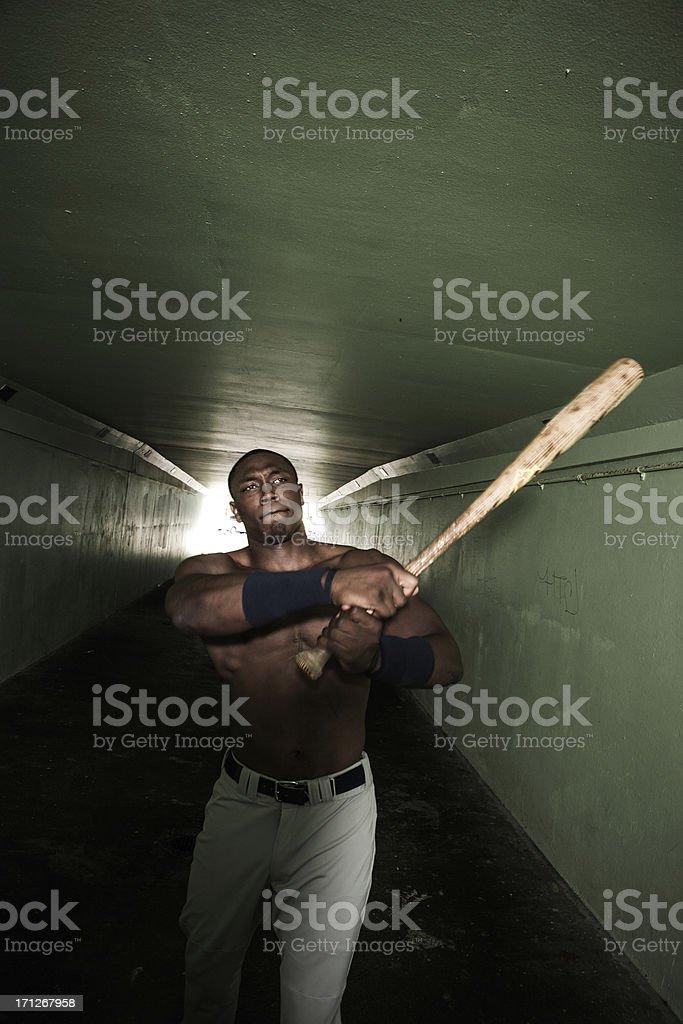 Baseball player swinging bat stock photo